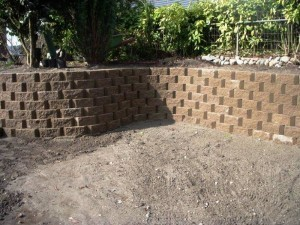 New brick-colored concrete retaining wall