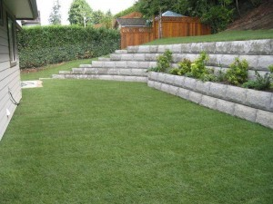 Concrete Block Retaining Wall on Green Lawn