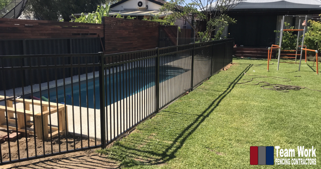 Frameless Glass Pool Fence combined with Galvanised Steel Pool Fencing