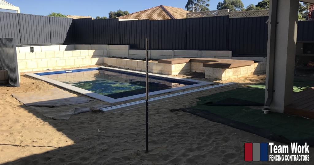 Installing Feature Pool Fencing with Glass Pool Fence and Tubular Posts