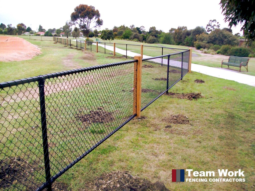 Custom black chainlink fence installation in Perth Western Australia