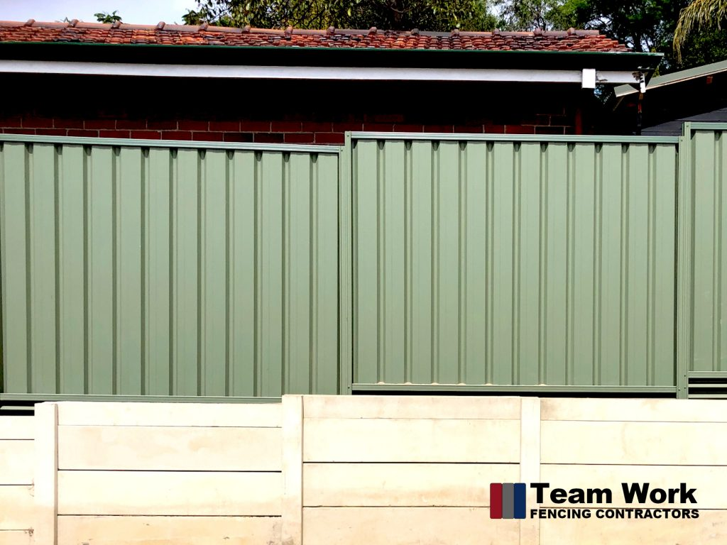 Green Colorbond Fence with Allywall Retaining