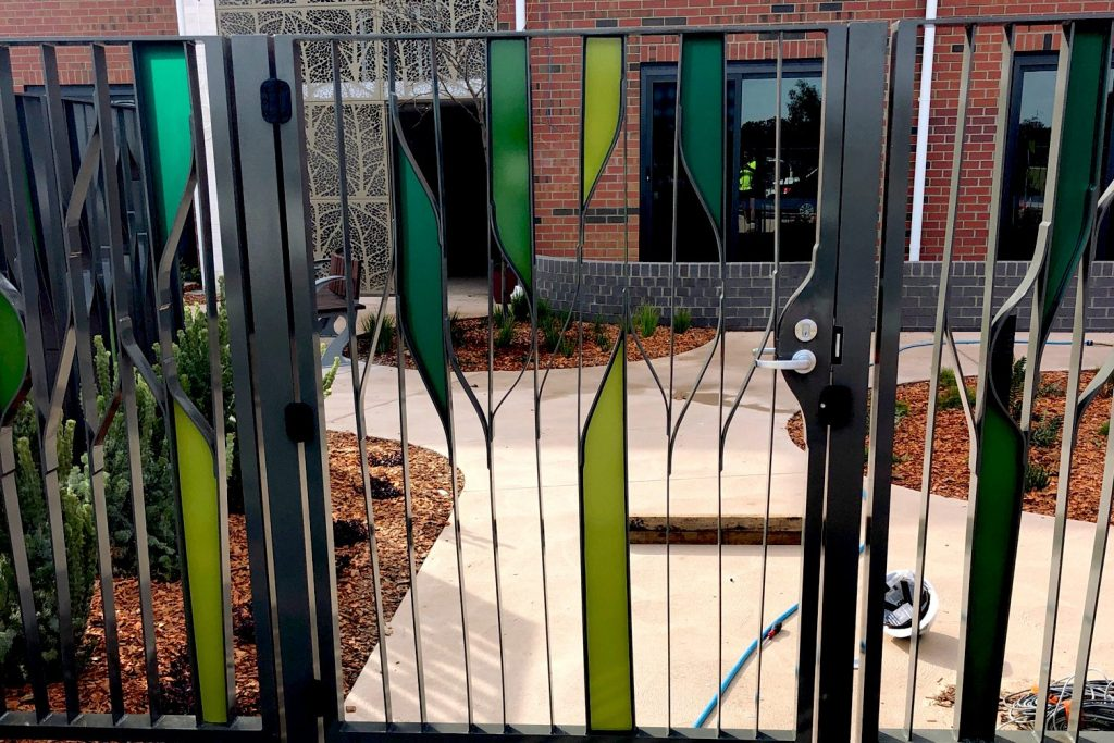 Feature Fence Art Deco Gates Installation by Team Work Fencing Contractors