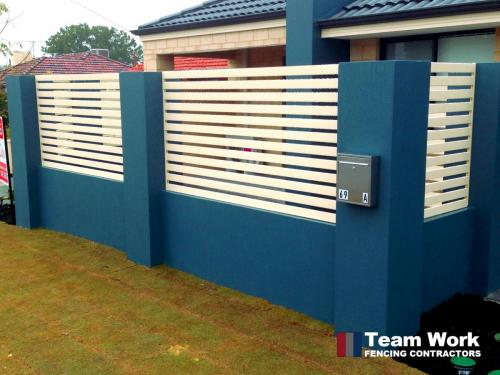 White EZI Slat fence in blue fence panel contast installed in Perth