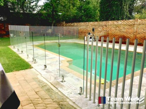 Custom Glass Pool Fence with Free Standing Tube Posts in Perth