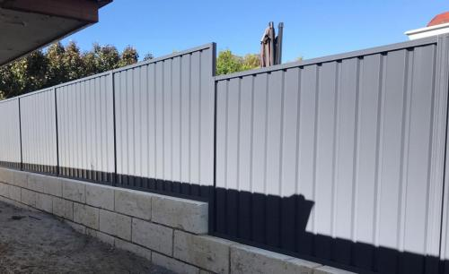 Colorbond fence and limestone